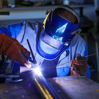 A welder welds metal together